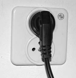 Twin mains socket in use