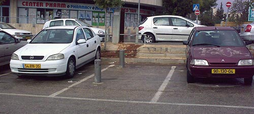 Parking spot with poles