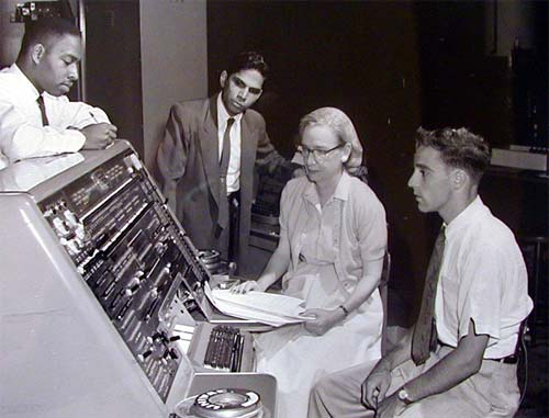 Grace Hopper next to Univac 1 console,1957