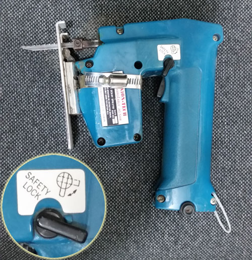 Jigsaw with unmarked safety lock